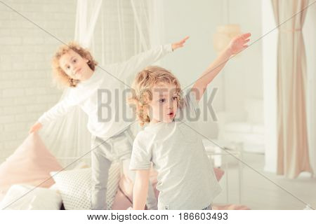 Brothers Standing On The Bed