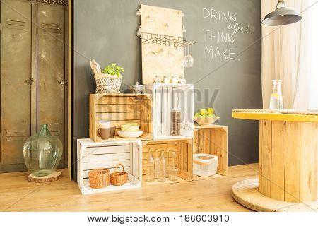 Crates Against Blackboard Wall