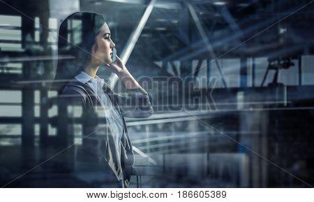Elegant businesswoman in office interior. Mixed media