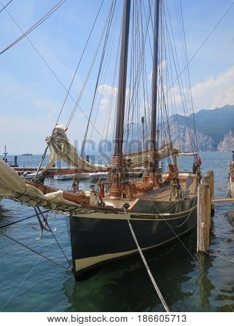 Ship with sailing boat sailing on water tourism