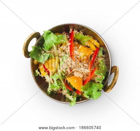 Indian restaurant dish, quinoa salad in copper bowl isolated on white, top view. Lettuce and fruits mix. Eastern local cuisine food.