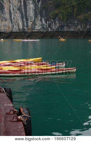Halong Bay Vietnam - March 7 2017: set of color kayaks near Cat Ba island Halong Bay Vietnam
