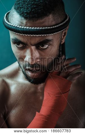 Muay Thai Athlete Training At Thai Boxing Indoors, Ultimate Fight Concept