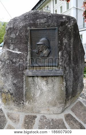 MEIRINGEN, SWITZERLAND - MAY 6, 2017: A plaque at the Reichenbach falls where according Sir Arthur Conan Doyle Sherlock Holmes vanquished Professor Moriarty on May 4, 1891