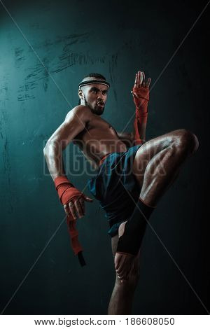 Low Angle View Of Determined Muay Thai Fighter Training Thai Boxing, Ultimate Fight Concept