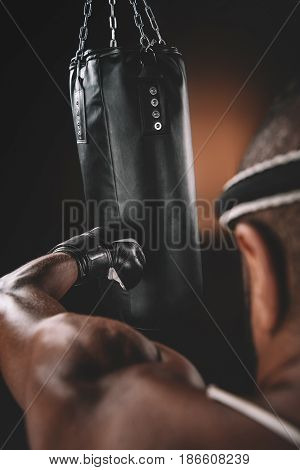 Close-up View Of Muay Thai Athlete Training At Thai Boxing With Punching Bag, Action Sport Concept