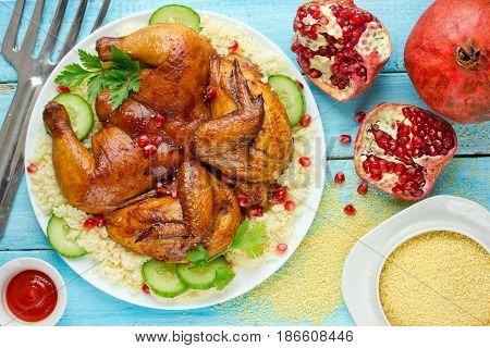 Baked whole chicken with perfect crispy skin pomegranate cucumber couscous for garnish