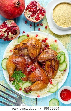 Roast chicken with couscous pomegranate cucumber salad