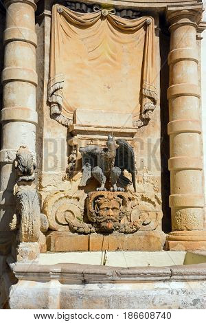 Sculpture and drinking fountain on the front of the main guard building in St Georges Square Valletta Malta Europe.