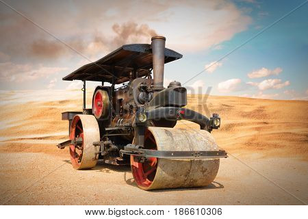 Old steam roller on riding on desert after apocalypse. Steam engine from 19th century on retro style collage.