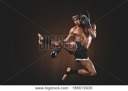 Side View Of Angry Trainign Muay Thai Fighter In Boxing Gloves, Action Sport Concept