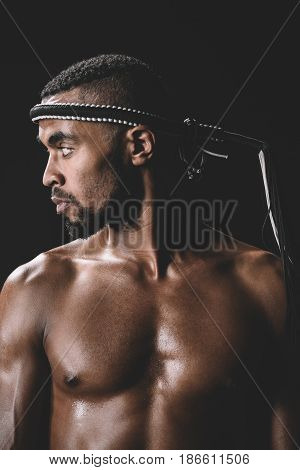 Side View Of Confident Muay Thai Fighter With Mongkhon On Head Isolated On Black
