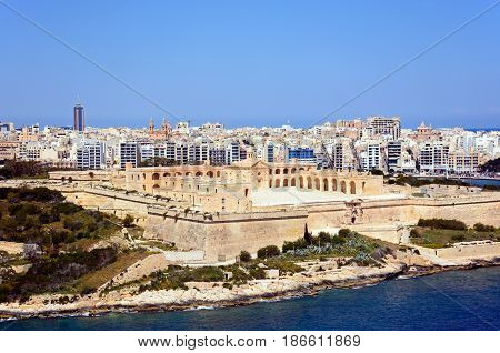 Elevated view of Manoel Fort on Manoel Island seen from Valletta with Sleima to the rear Valletta Malta Europe.