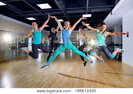 Group training of girls in the gym.