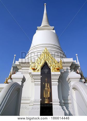 one of thirteen white pagoda with glass cabinet enshrined golden standing Buddha statue at wat Asokaram, Thailand, this temple is a popular tourist destination near Bangkok
