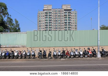 TAICHUNG TAIWAN - DECEMBER 10, 2016: Scooters parked on the street.