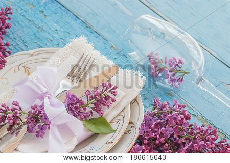 Tableware And Silverware With Violet Lilac On The Wooden Backgro