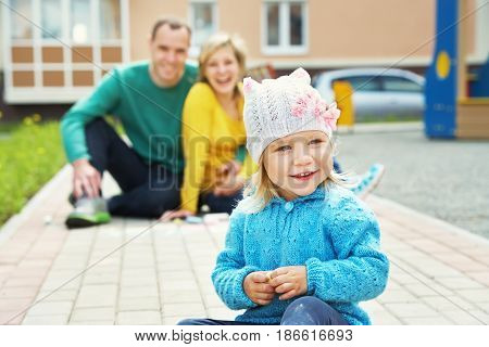 selective focus. outdoor playing family. young parents with a baby for a walk in the summer. Mom, dad and child
