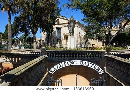 VALLETTA, MALTA - MARCH 30, 2017 - View of the Stock Exchange in Upper Barrakka gardens with the Saluting Battery archway in the foreground Valletta Malta Europe, March 30, 2017.