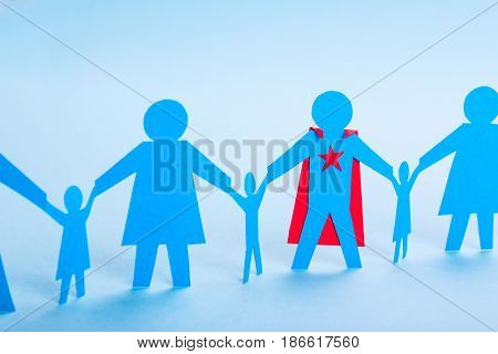 Super dad superhero. Best Daddy in the World. Paper family holding hands and dad's superhero costume