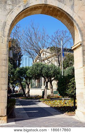 VALLETTA, MALTA - MARCH 30, 2017 - View through an archway towards the Upper Barrakka Gardens with the Stock Exchange to the rear Valletta Malta Europe, March 30, 2017.