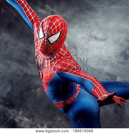 SEINT-PETERSBURG, RUSSIA - MAY 21, 2016: Cosplayer dressed as Spiderman. Close-up, hands. Shoot spider web. Comic Con in Russia