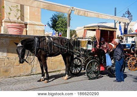 VALLETTA, MALTA - MARCH 30, 2017 - Horse Drawn carriage outside the Upper Barrakka gardens Valletta Malta Europe, March 30, 2017.