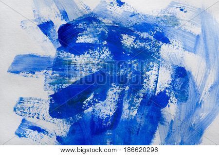 Watercolor paint brush blue strokes on paper texture, color spots on white abstract background