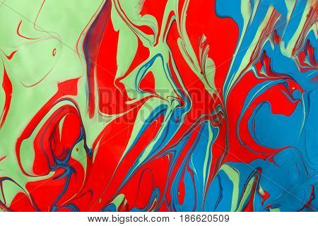 Liquid paper marbling paint background. Fluid painting abstract texture, art technique. Colorful mix of acrylic vibrant colors.
