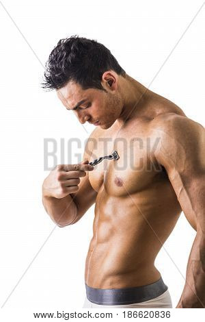 Close up Handsome Muscled Young Man Shaving his Chest with Manual Shaver, Isolated on White Background.