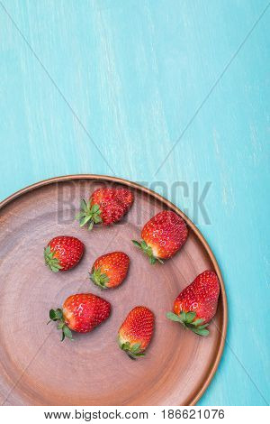 Fresh Red Strawberries On Ceramic Plate On Blue Wooden Tabletop, Berries Background Concept
