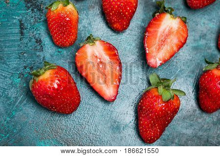 Top View Of Whole And Sliced Ripe Red Strawberries On Tabletop, Berries Top View Concept