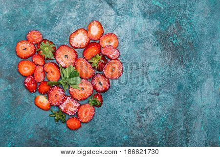 Sliced Strawberries In Heart Shape On Tabletop Background With Copy Space, Berries Top View Concept