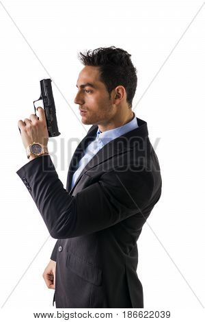 Elegant man with gun, dressed as a spy or secret agent, isolated on white