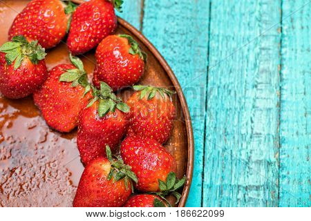 Fresh Red Strawberries In Ceramic Plate On Turquoise Wooden Tabletop, Berries Top View Concept