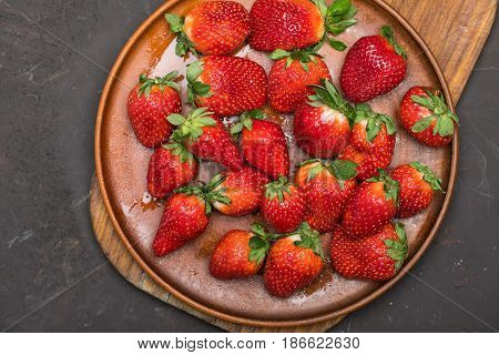 Fresh Red Strawberries In Ceramic Plate On Wooden Cutting Board, Berries Top View Concept