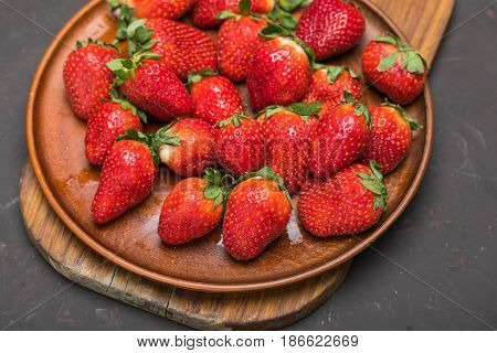 Fresh Red Strawberries In Ceramic Plate On Wooden Cutting Board, Berries On Wood Concept