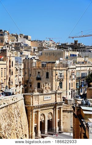 VALLETTA, MALTA - MARCH 30, 2017 - Elevated view of Victoria Gate with town buildings to the rear Valletta Malta Europe, March 30, 2017.