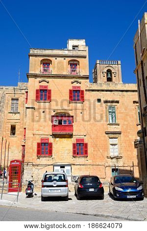 VALLETTA, MALTA - MARCH 30, 2017 - The Bridge bar building along Liesse with a red British telephone box to the left Valletta Malta Europe, March 30, 2017.