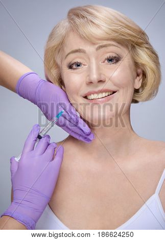 closeup portrait of attractive old mature caucasian woman