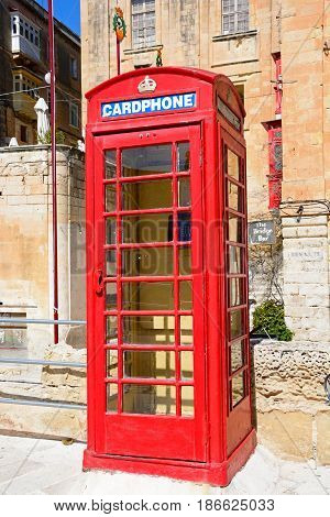 VALLETTA, MALTA - MARCH 30, 2017 - Traditional British red telephone box along Liesse with the Bridge Bar to the rear Valletta Malta Europe, March 30, 2017.