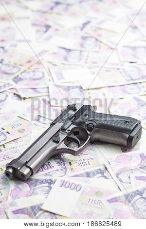 Handgun and czech paper money.