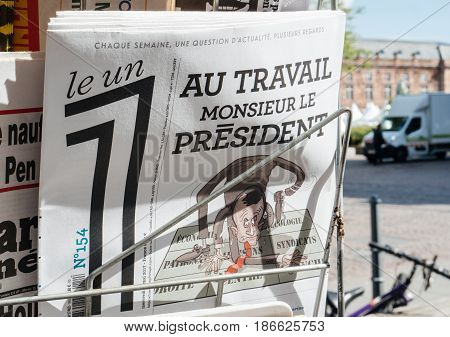 STRASBOURG FRANCE - MAY 15 2017: Le Un French magazine with Au Travail Monsieur le president - to Work mister President text on cover after handover ceremony presidential inauguration of the newly elected French President Emmanuel Macron in Paris France
