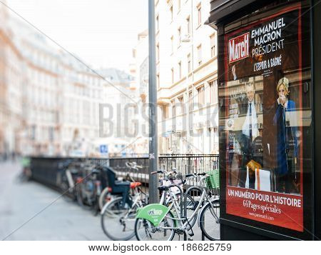 STRASBOURG FRANCE - MAY 15 2017: French city press kiosk with Paris Match magazine Emmanuel Macron and his wife Brigitte Trogneux during handover ceremony presidential inauguration of the newly elected French President Emmanuel Macron in Paris France