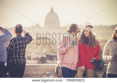 ROME, ITALY. January 10, 2016: Tourists and people on the Pincio terrace in Rome in Italy. View of St. Peter and the city of Rome.