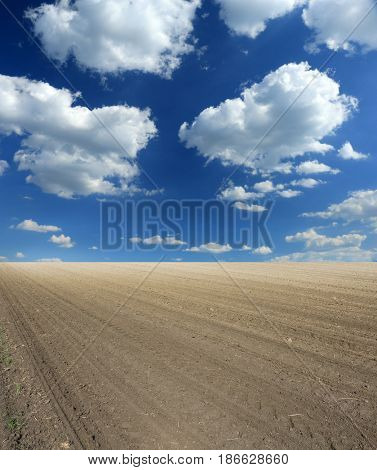 arable land and clouds