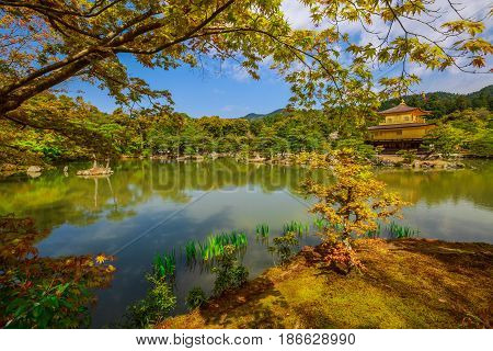Scenic landscape of famous landmark and Unesco site of Kyoto, Kinkakuji or Rokuonji. The Golden Pavilion, whose top two floors are completely covered in gold leaf, is a Zen temple of Rinzai sect.