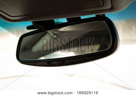automobile rear view mirror. close up. interior