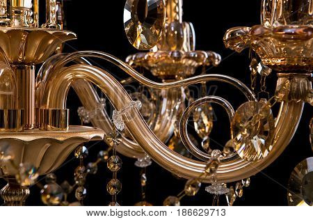 Contemporary glass crystal chandelier isolated on black background. close-up chandelier. crystal