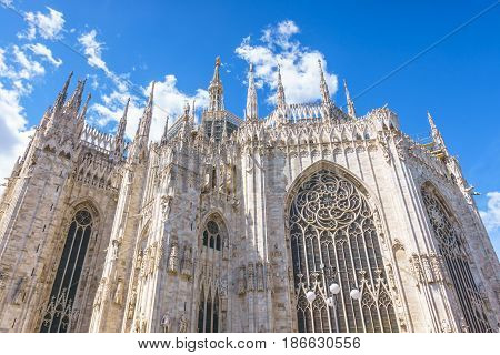 Milan Italy - April 28 2017: Daytime view of famous Milan gothic cathedral church (Duomo di Milano) with blue sky background in Milan Italy.